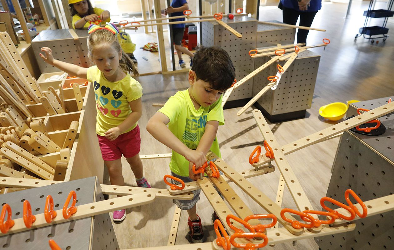 Children build their own designs in the Building Buffalo exhibit at Explore & More Ralph C. Wilson Jr. Children's Museum. (Derek Gee/Buffalo News)