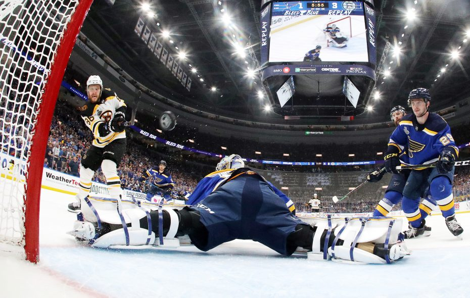 David Pastrnak of the Boston Bruins scores a third period goal past Jordan Binnington of the St. Louis Blues in Game Six of the 2019 NHL Stanley Cup Final Sunday at Enterprise Center in St Louis. (Getty Images)