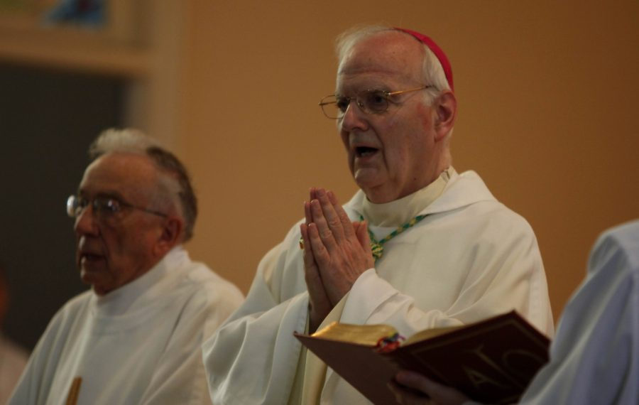 Bishop Donald W. Trautman prays during the 175th anniversary of SS. Peter and Paul Catholic Church in Williamsville in 2011. Trautman's handling of clergy sexual abuse cases in the Buffalo Diocese in the 1980s has been criticized by a Pennsylvania grand jury report and James Bottlinger, a man who says he was abused by the Rev. Michael Freeman. In 1990, Trautman was appointed bishop of the Erie Diocese. He retired in in 2012. (News file photo)