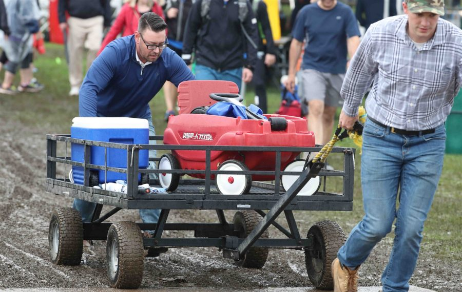 Runners, walkers, vendors and volunteers all dealt with muddy conditions at Delaware Park for Thursday's J.P. Morgan Corporate Challenge, which left behind extensive damage to the park. (James P. McCoy/Buffalo News)