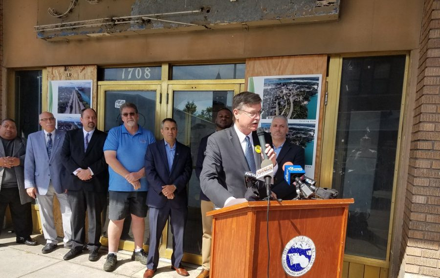 Niagara Falls Mayor Paul A. Dyster speaks at a news conference in front of the old Jenss Department Store on Main Street in Niagara Falls on June 19, 2019. Bob Richardson of Blue Cardinal Capital is third from left. (Thomas J. Prohaska/Buffalo News)