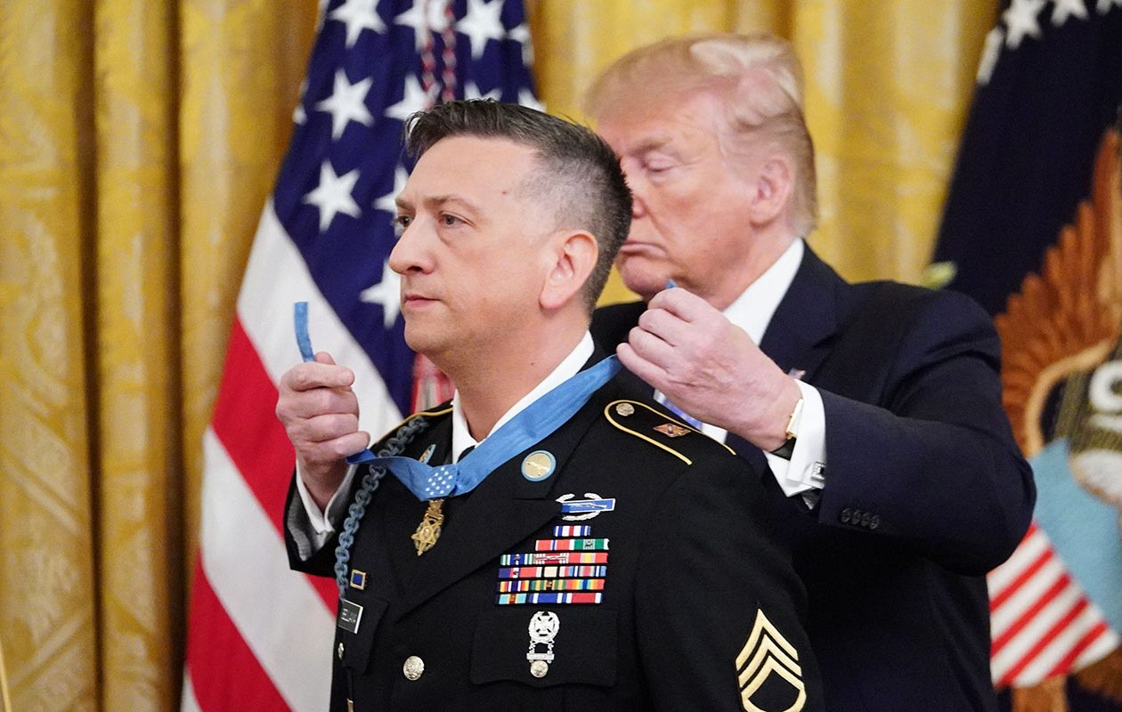 President Donald Trump presents the Medal of Honor to David Bellavia in the East Room of the White House in Washington, D.C. on June 25. (Photo by MANDEL NGAN / AFP)