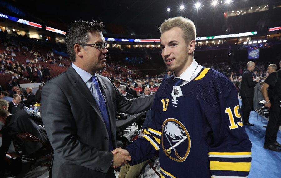 Lukas Rousek, 160th overall pick of the Buffalo Sabres, is greeted by amateur scouting director Ryan Jankowski on the draft floor during Rounds 2-7 of the 2019 NHL Draft at Rogers Arena on Saturday in Vancouver. (Photo by Dave Sandford/NHLI via Getty Images)