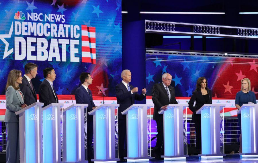 "Democratic presidential candidates take part in the second night of the first Democratic presidential debate in Miami last month. The ""debates"" are more like a bad TV show. (Getty Images)"