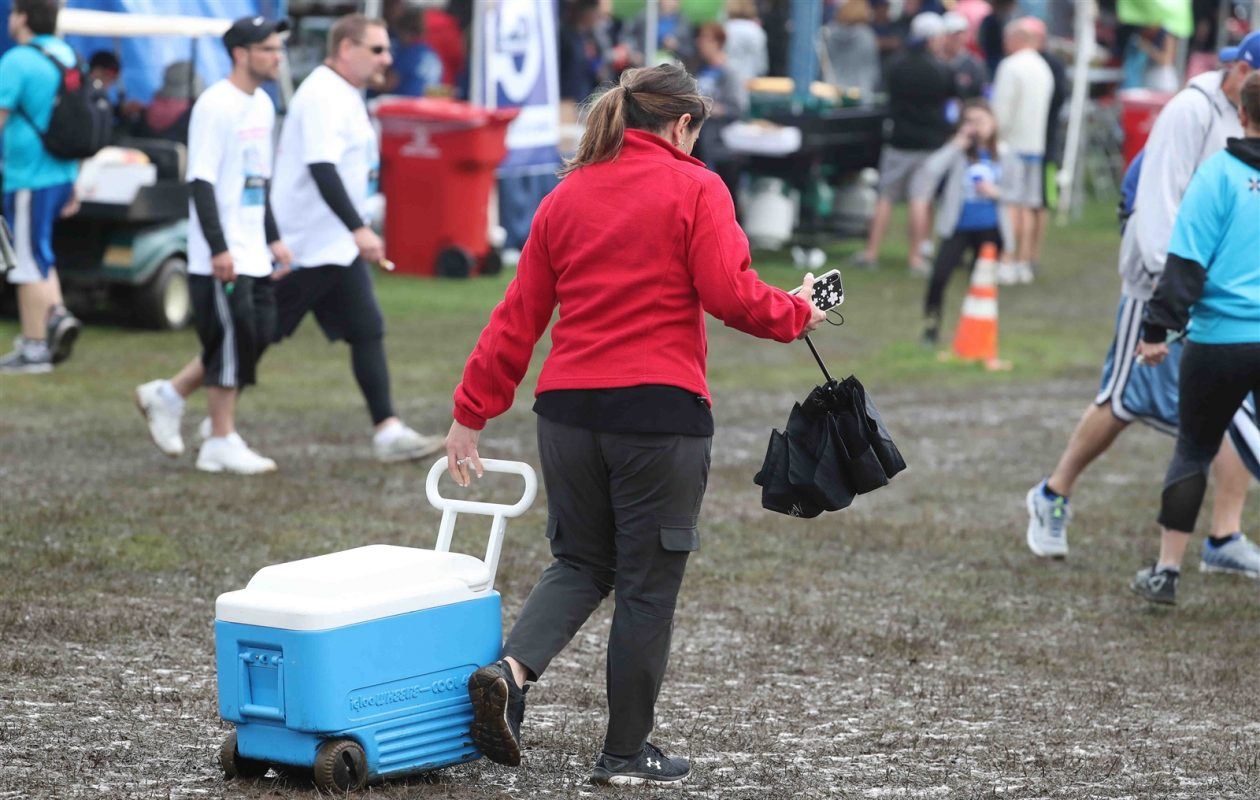 Rain and heavy pre- and post-race traffic left a large swath of Delaware Park a muddy mess following this year's J.P. Morgan Corporate Challenge. (James P. McCoy/Buffalo News)