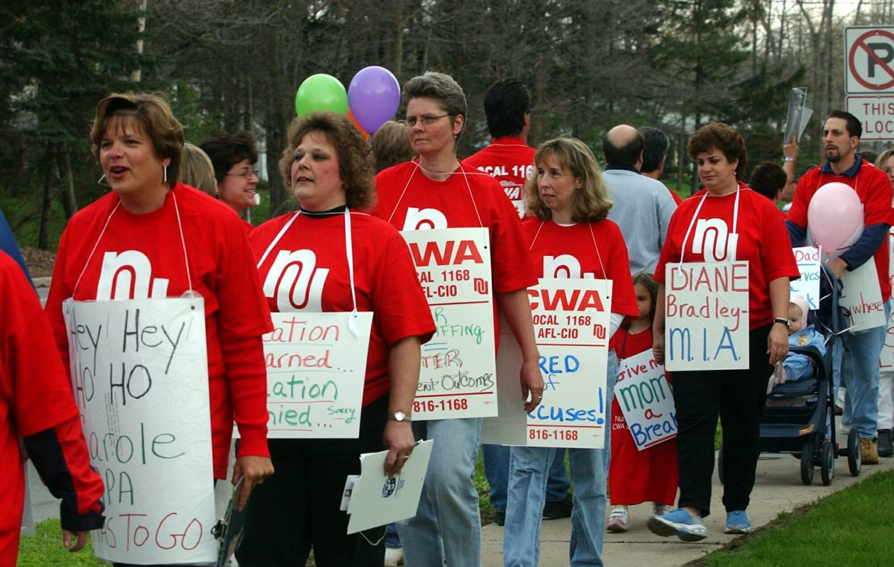 Members of CWA Local 1168 walk an informational picket line in front of Millard Fillmore Suburban Hospital during an earlier contract dispute with Kaleida Health. (Robert Kirkham/News file photo)