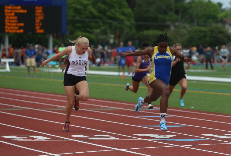 Orchard Park's Jenna Crean was involved in four close finishes Saturday. Here, Lockport's Kahniya James wins the Division I 100-meter dash during the Section VI State Qualifying meet at Williamsville South. Crean anchored OP's win in the 4x100 relay later in the meet. (John Hickey/Buffalo News)