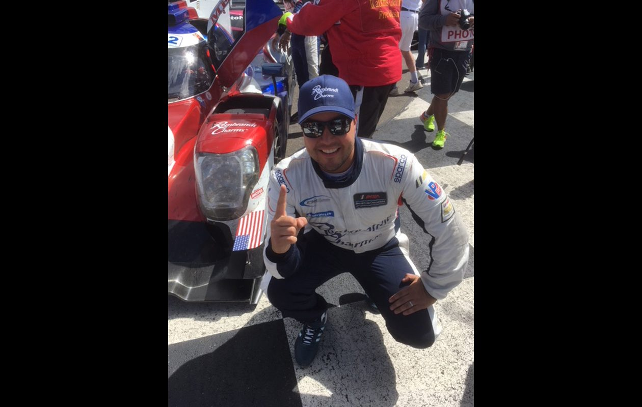 Eric Lux lets people know who's No. 1 in Victory lane at Watkins Glen. (Photo courtesy of Larry Ott)