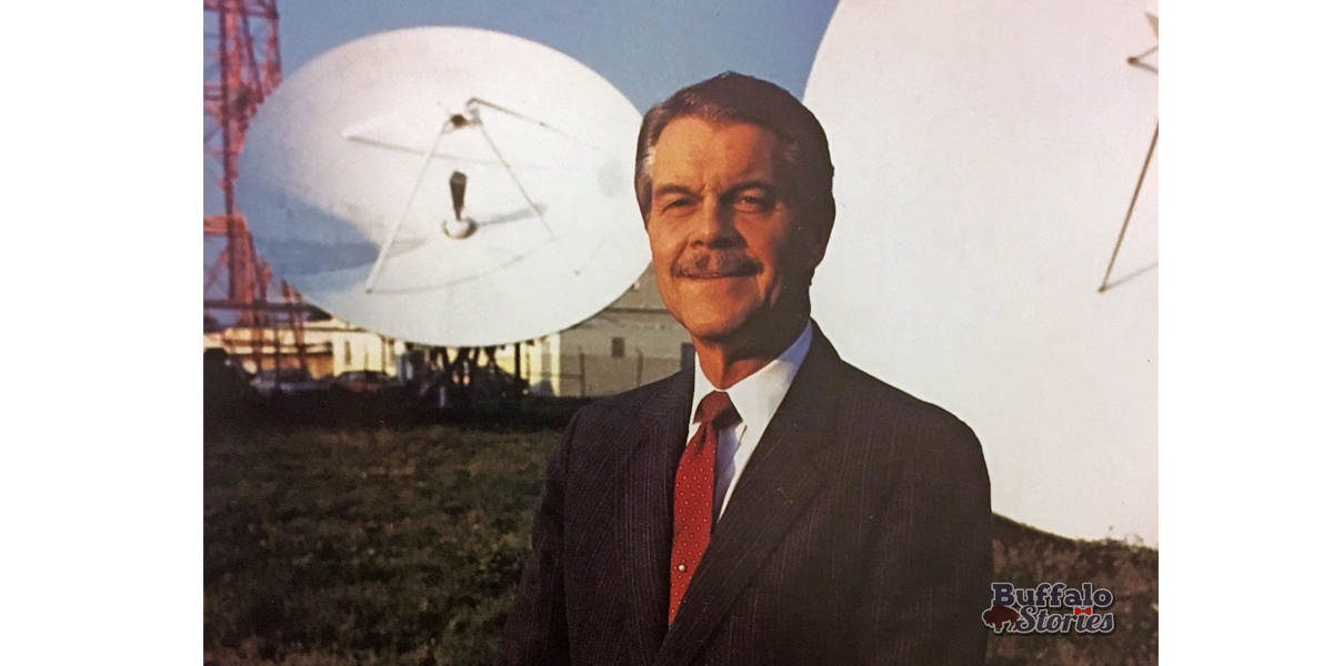 Channel 4 President and General Manager Les Arries stands among the station's satellite dishes, early 1980s.