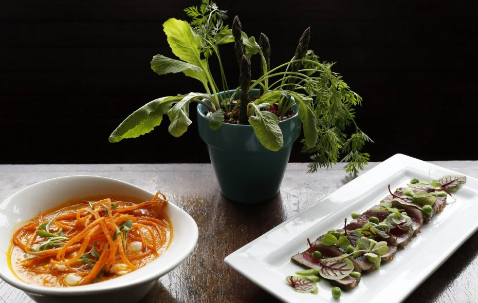 Dishes on Martin Danilowicz's spring menu at Roost include, from left: carrot soup, potted hummus and tuna on sorrel. (Sharon Cantillon/Buffalo News)
