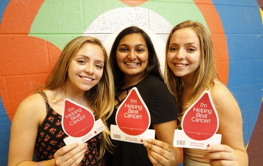From left, Ava Horn, Avantika Sridhar and Brooke Horn organized a fundraiser which raised over $30,000 for the Leukemia/Lymphoma Society. (Derek Gee/Buffalo News)
