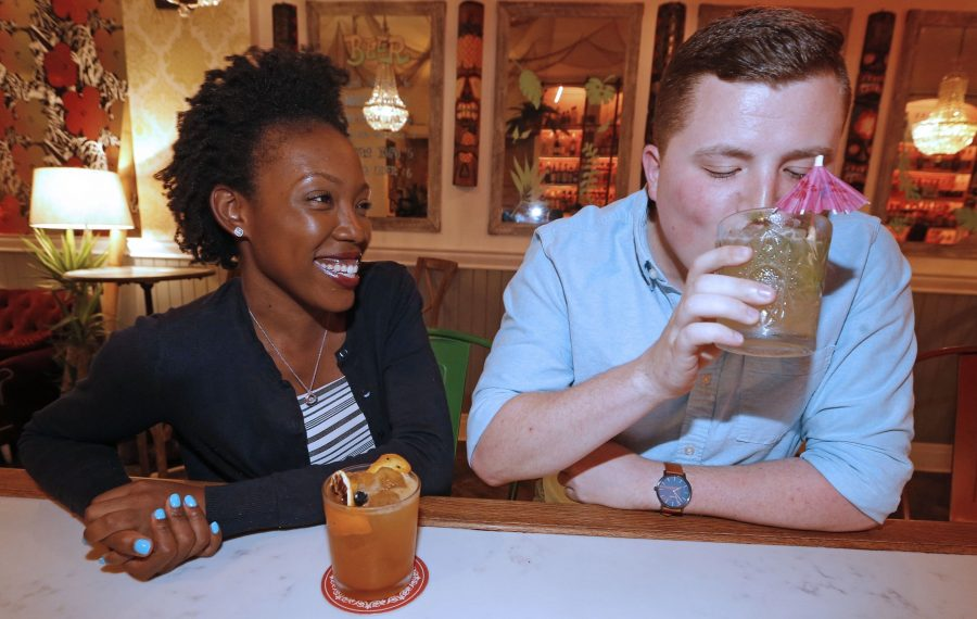 Kadijah McKenzie, left, enjoys a Cobra's Fang cocktail while watching Connor Brown sip a vintage drink that originated in Cairo, Egypt. (Robert Kirkham/Buffalo News)