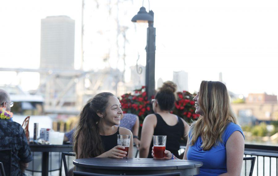 Cait Smith, left, and Kara Lash, of Rochester, enjoy a a beer on the patio at Buffalo RiverWorks. (Sharon Cantillon/Buffalo News)