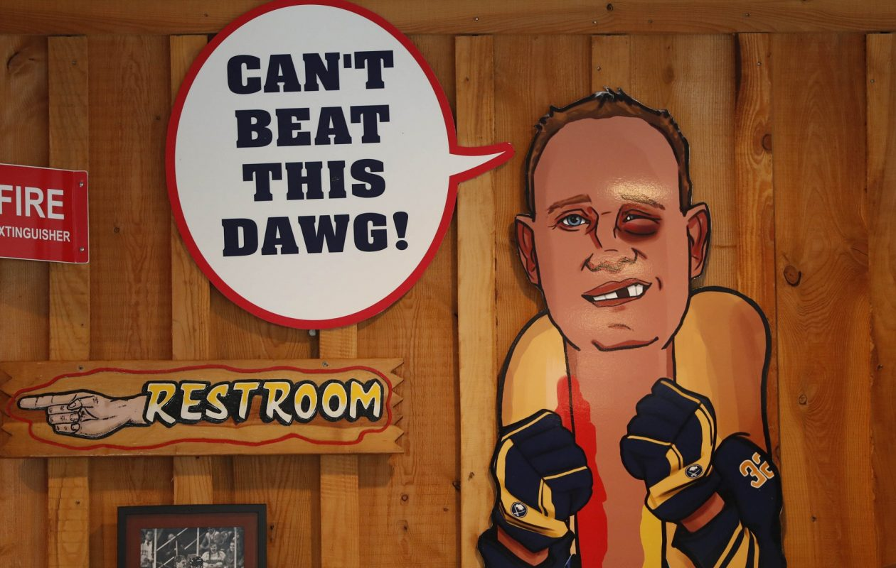 The caricature of Rob Ray as a hot dog has a prominent place in Rayzor's. (Sharon Cantillon/Buffalo News)