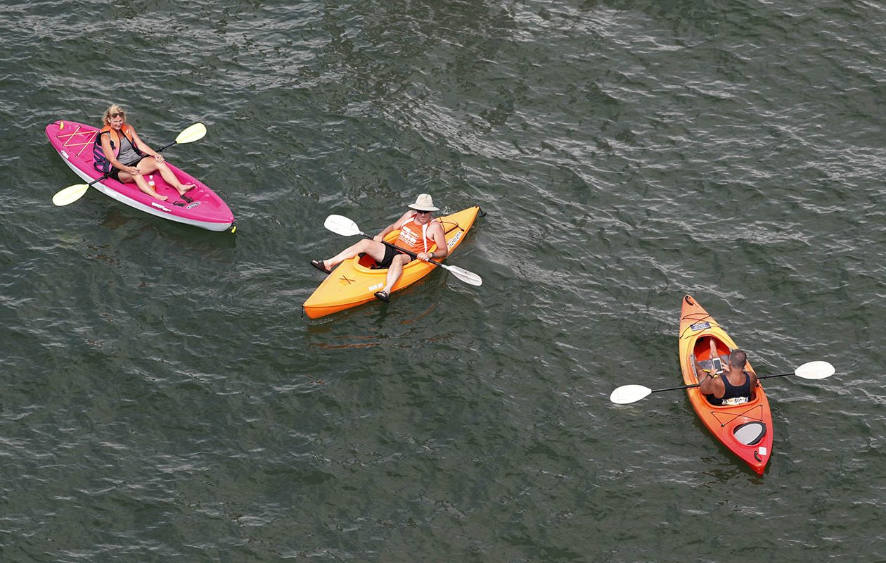 Kayakers float in the Buffalo River on a warm summer day on Thursday, July 4, 2019. (Sharon Cantillon/Buffalo News)