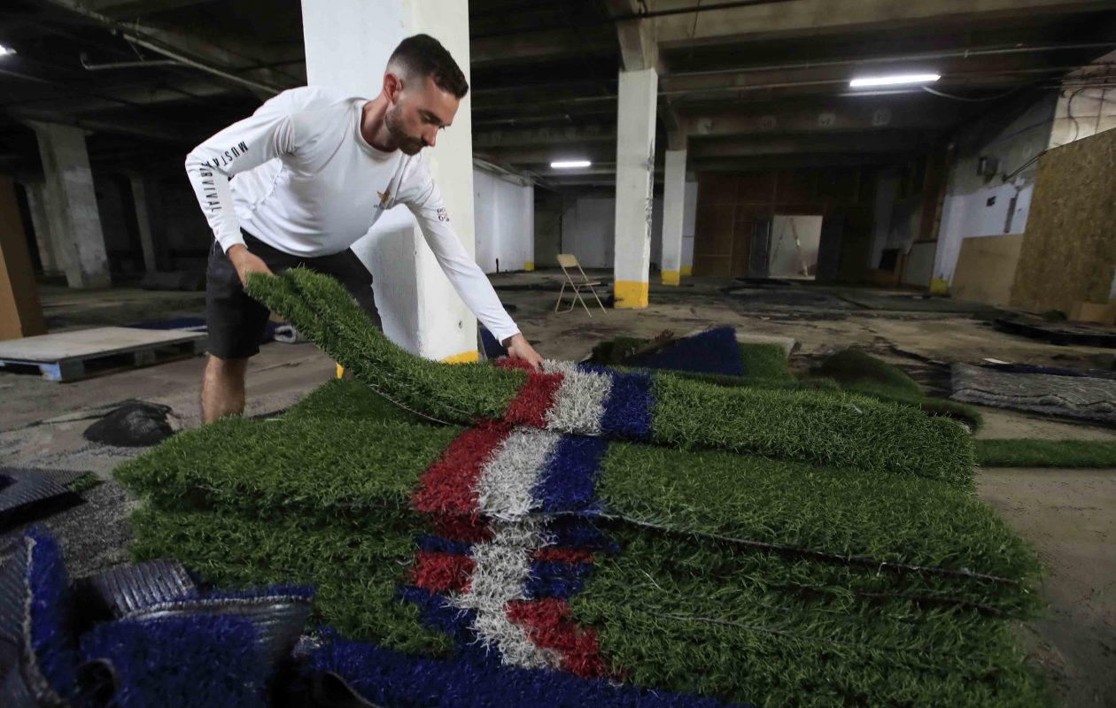 Pat Brady looks over some of the 40,000 square feet of artificial Bills turf that he bought at auction. The turf was used from the 2011-2018 seasons. (Harry Scull Jr./Buffalo News)