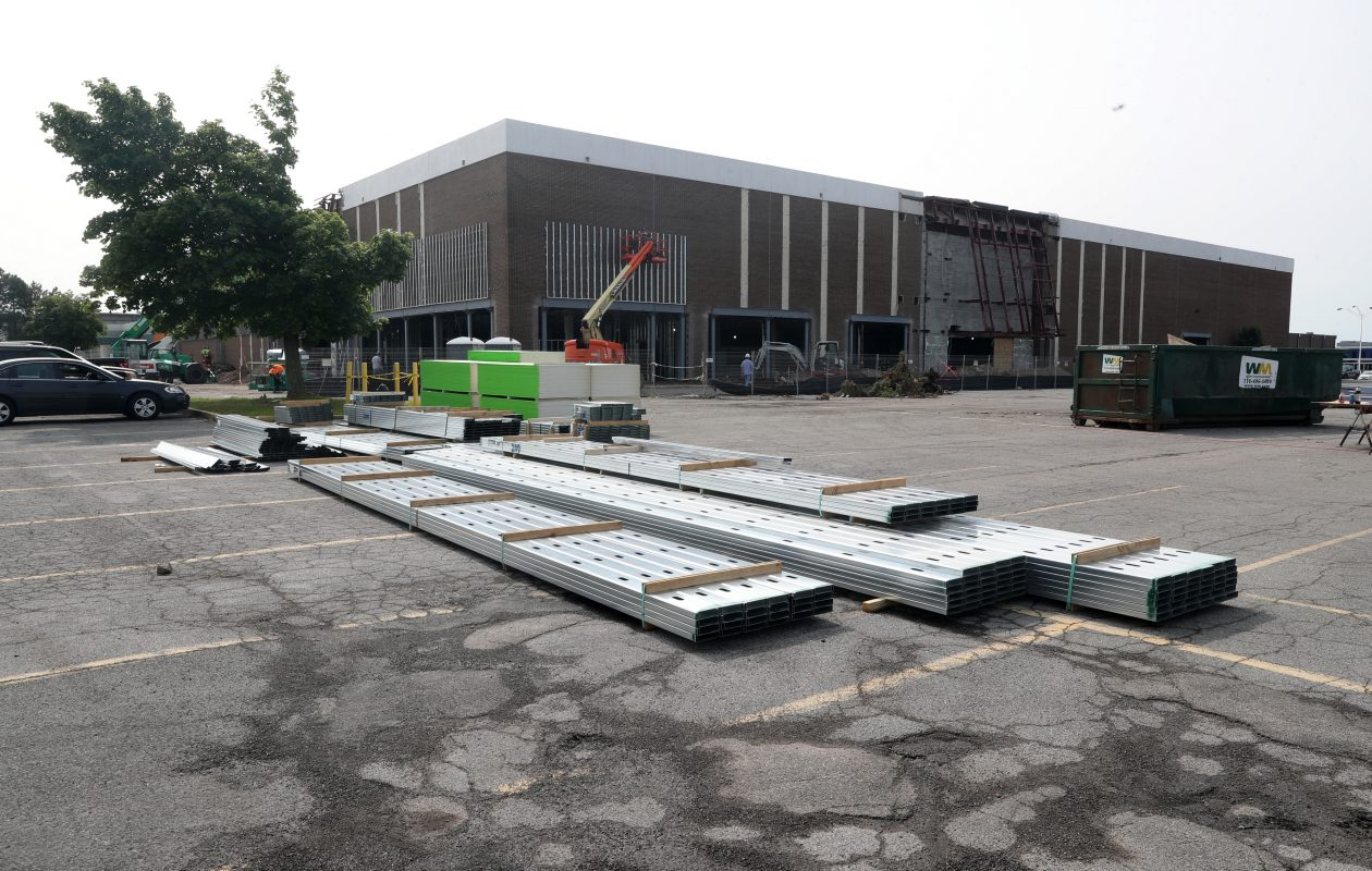Construction continues Tuesday, July 9, 2019, at the former Bon-Ton store at the Eastern Hills Mall, which was the scene of a fire Monday night. The store is being renovated by Raymour & Flanigan. (John Hickey/Buffalo News)