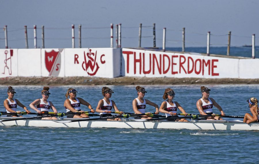 The West Side Rowing Club U19 8 women's team competes in the first heat in the 106th annual West Side Regatta at 1 Rotary Row, Buffalo near the Peace Bridge. Sunday, July 14, 2019.  (Robert Kirkham/Buffalo News)