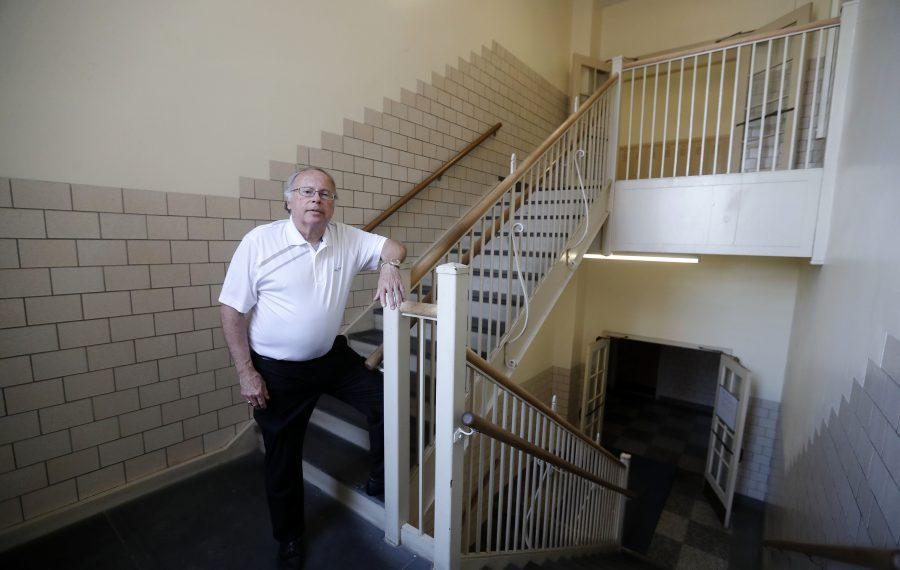 John R. Duerr, director of development/project manager for the KenTon Elmwood Commons, stands in the hallway of the former Philip Sheridan Elementary School. (Mark Mulville/Buffalo News)