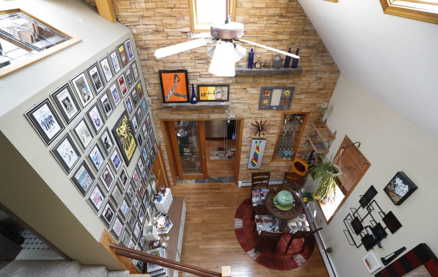 Thom Knab, an art teacher and volleyball coach, lives in a cottage on Buffalo's West Side. It features an open floor plan and five skylights. His garden is one of the more than 430 open to visitors during Garden Walk Buffalo, July 27-28. (Sharon Cantillon/Buffalo News)