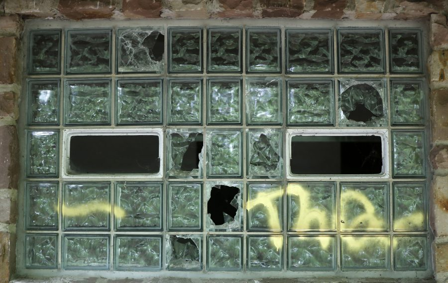 Among the problems at Chestnut Ridge Park are some broken and vandalized glass block windows in a bathroom. (Mark Mulville/Buffalo News)