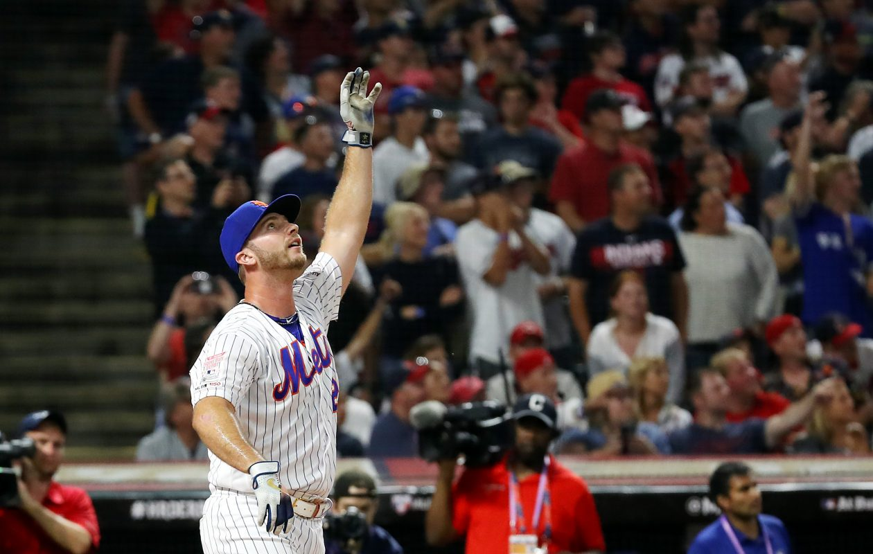 Pete Alonso of the New York Mets celebrates winning the T-Mobile Home Run Derby Monday at Progressive Field in Cleveland. (Gregory Shamus/Getty Images)
