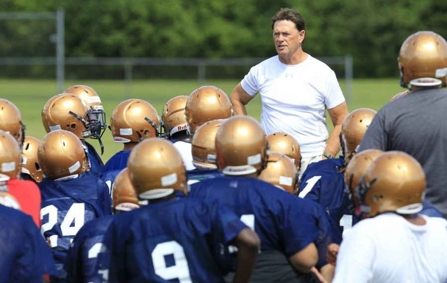 John Faller believed in hard work, discipline and accountability -- lessons he taught over the years to players he coached in football and lacrosse. (Harry Scull Jr./Buffalo News file photo)