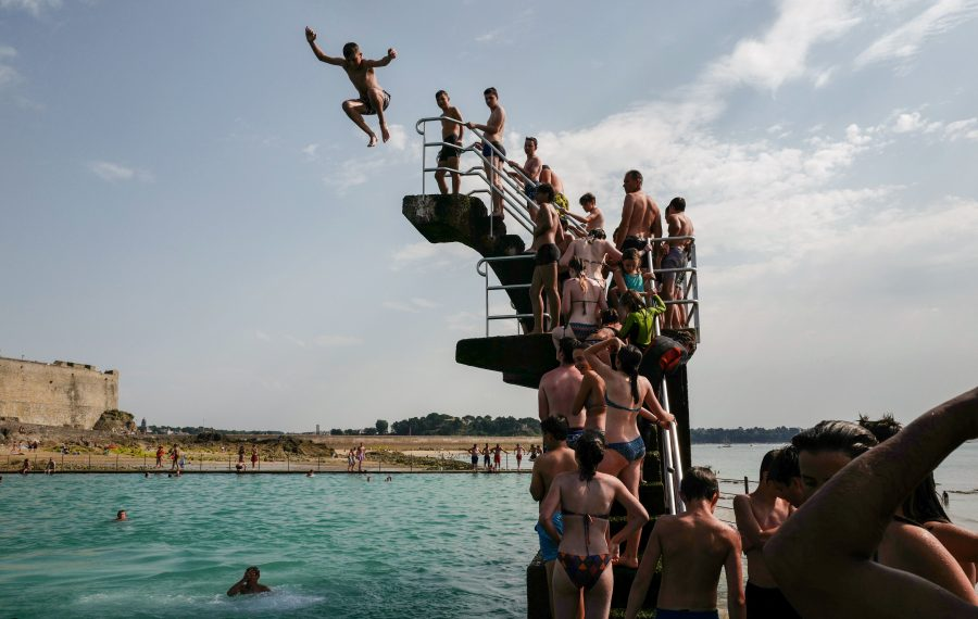 Swimmers line up to dive into the landmark sea pool of Saint-Malo, Brittany, on July 23, 2019 as a new heatwave blasted into northern Europe that could set records in several countries.  (VALERY HACHE/AFP/Getty Images)
