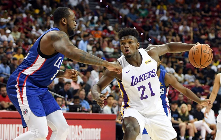Nick Perkins of the Los Angeles Lakers drives against Cliff Alexander of the LA Clippers during the 2019 NBA Summer League in Las Vegas. (Getty Images)