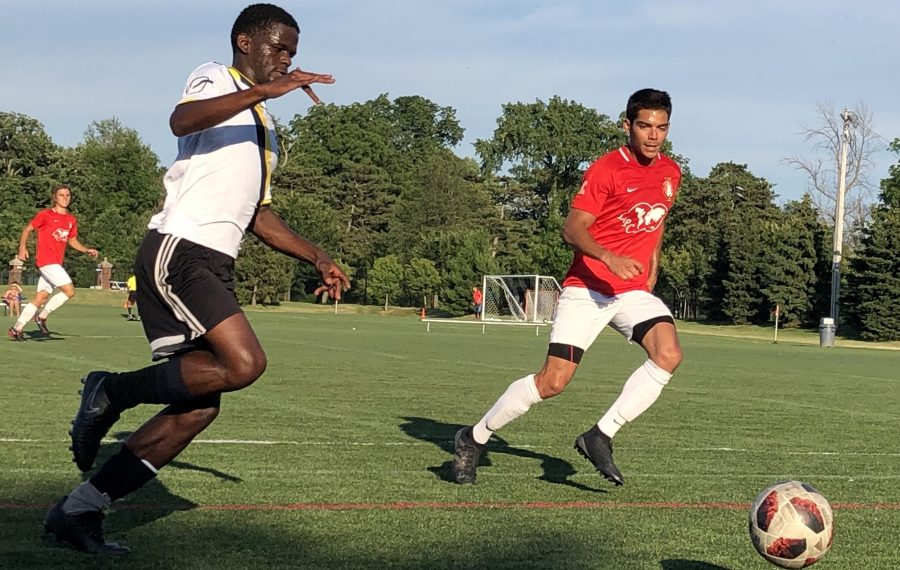 Mo Hussein, in white, dribbles at Sharpshooters' Cody Rouse earlier this season. The two teams match up again in the first round of the playoffs. (Ben Tsujimoto/News file photo)