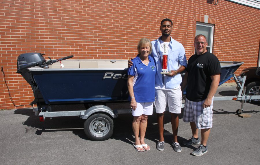 James Nix Jr. of Amherst won the grand prize in the 29th Erie Canal Fishing Derby. Also in the photo are derby organizers Lynn and Brandon Harrington. The grand prize was the boat, motor and trailer in the background. (Bill Hilts Jr./Buffalo News)