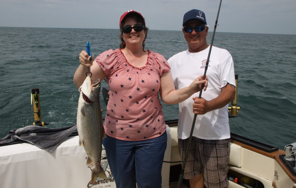 Kathy Calvert of Lynchburg, Virginia reeled in this chunky lake trout while fishing with Capt. Mike Johannes out of Wilson in Lake Ontario. (Bill Hilts, Jr. photo)