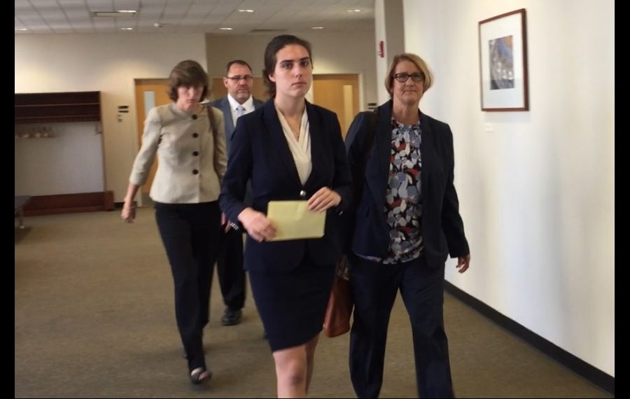 Hannah M. Christensen, center, leaves State Supreme Court on Wednesday morning accompanied by attorney Cheryl Meyers Buth, right, and her parents. (Aaron Besecker/Buffalo News)