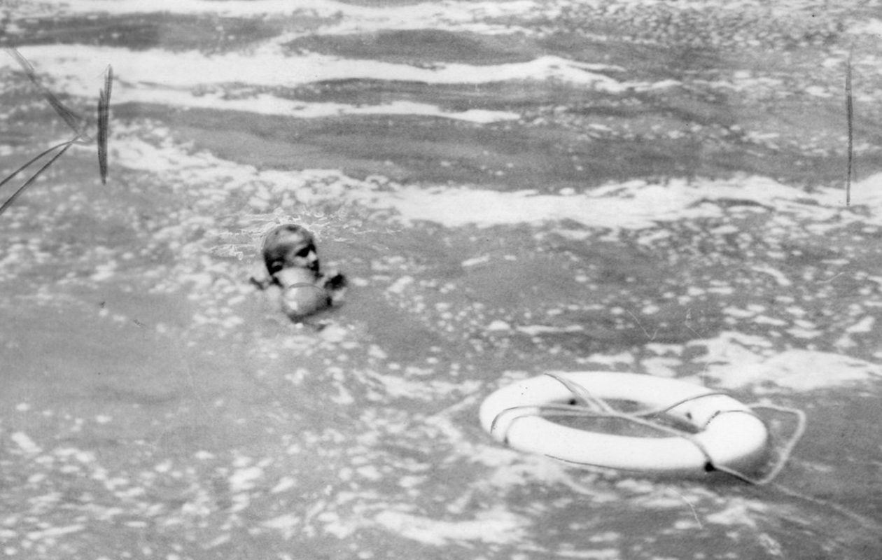 Roger Woodward, 7, floats in the water after surviving a plunge over the Horseshoe Falls, protected only by a life vest after a boating accident July 9, 1960. (Buffalo News file photo)