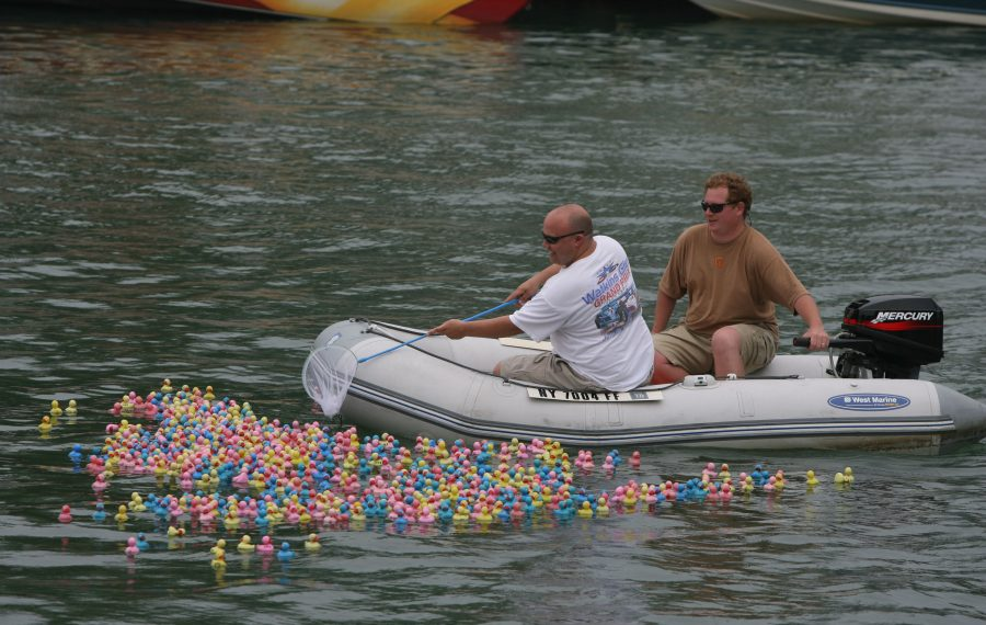 Officials get ready to scoop up the many multicolored rubber ducks in the rubber duck race, sponsored by Community Missions of Niagara Frontier at a previous Canal Fest in North Tonawanda. (News file photo)