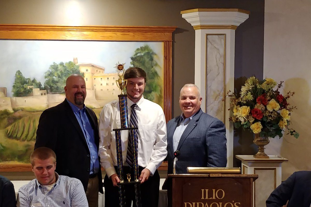 Brian Norsen of Frontier accepts the Colpoys-Barrows Award from Tom Prince, left, and Don Colpoys Jr., right, during the an event honoring Western New York's top scholastic baseball players at Ilio DiPaolo's.