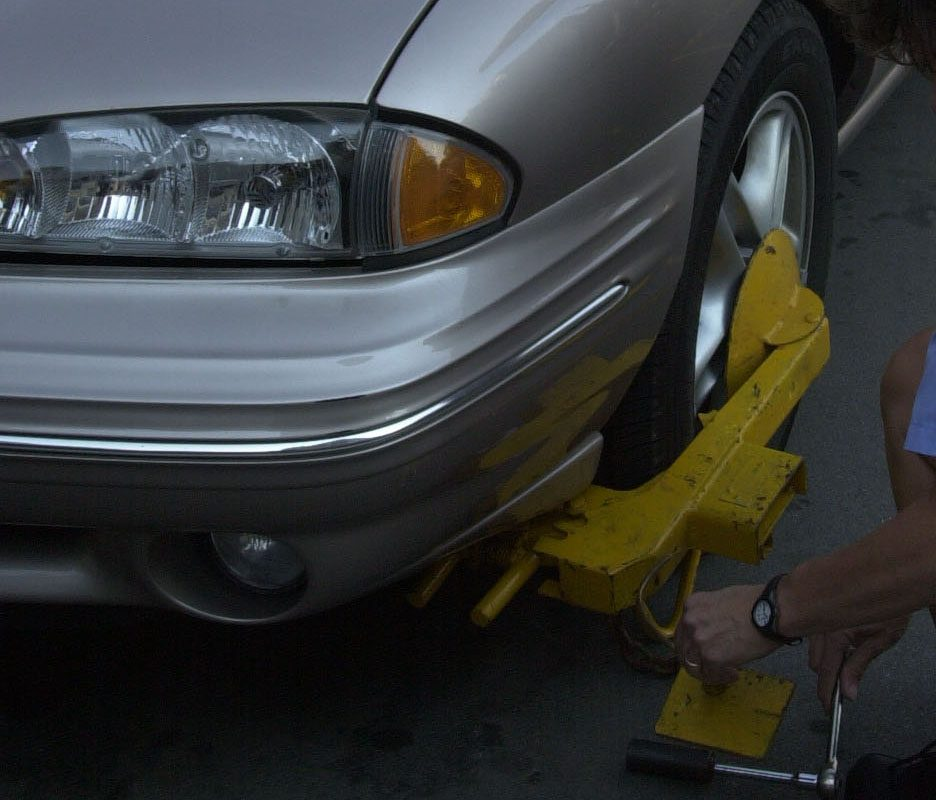 Council grills towing company on booting in parking lots
