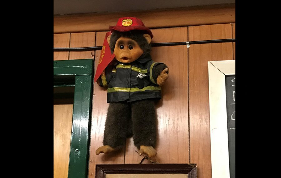 This monkey greeted a black rookie firefighter his first day on the job at Engine 4 in South Buffalo. (Photo courtesy of Rob Jackson)