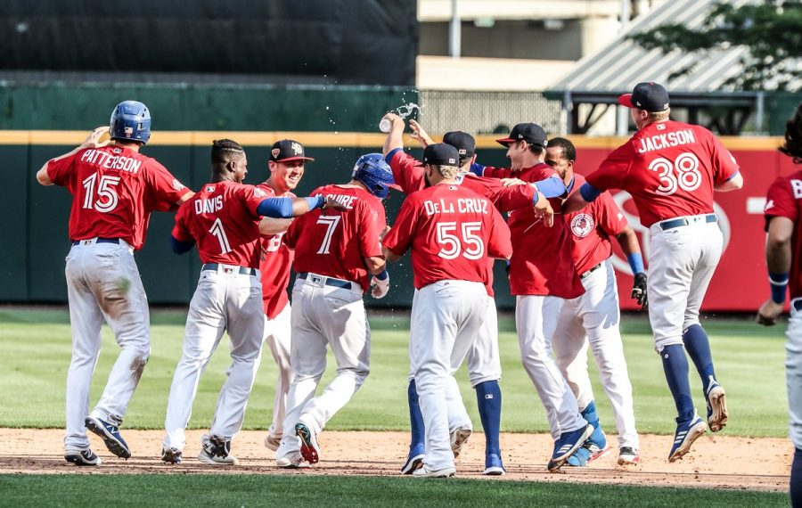 Bisons players mob Reese McGuire after his two-run single gave the Herd a 5-4 win over Lehigh Valley in the opener of Wednesday's double-header in Sahlen Field. (James P. McCoy/Buffalo News)