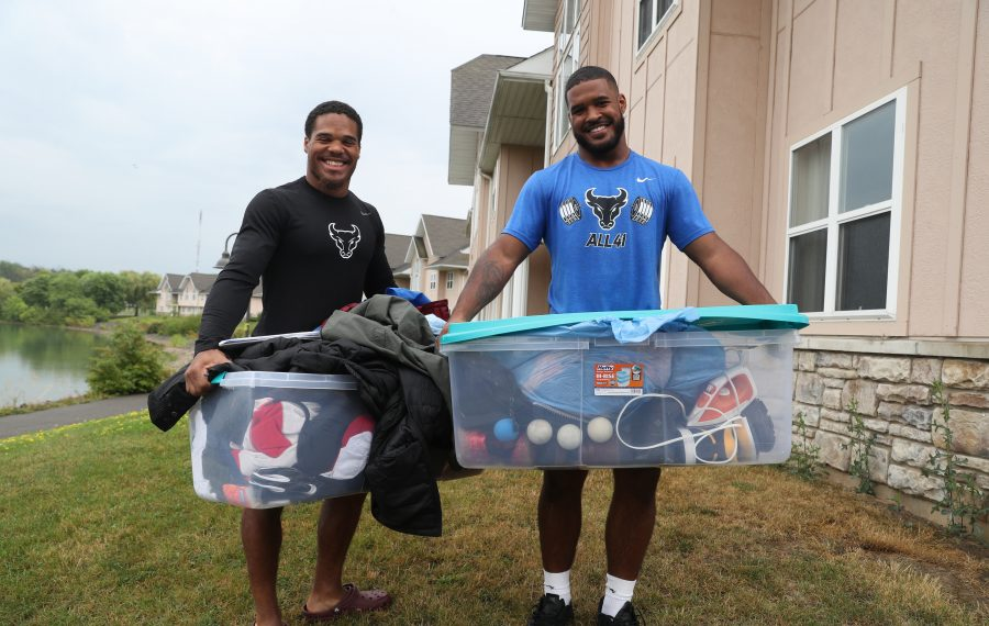 University at Buffalo football stars and twins Jaret Patterson, left, and James Patterson move their belongings into an apartment they are sharing together in Amherst on Saturday, Aug. 17, 2019. (James P. McCoy/Buffalo News)