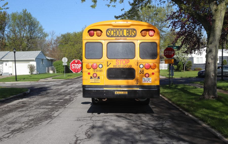 Beginning this fall, school districts will have the option of mounting cameras on the stop arms of school buses to photograph drivers who ignore the safety command. (John Hickey/News file photo)