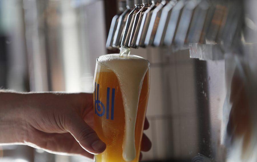 Belt Line Brewery at 545 Swan St. is one of the new craft breweries open in the area. The bartender is pouring a Farm To Tap honey kolsch. (Sharon Cantillon/Buffalo News)