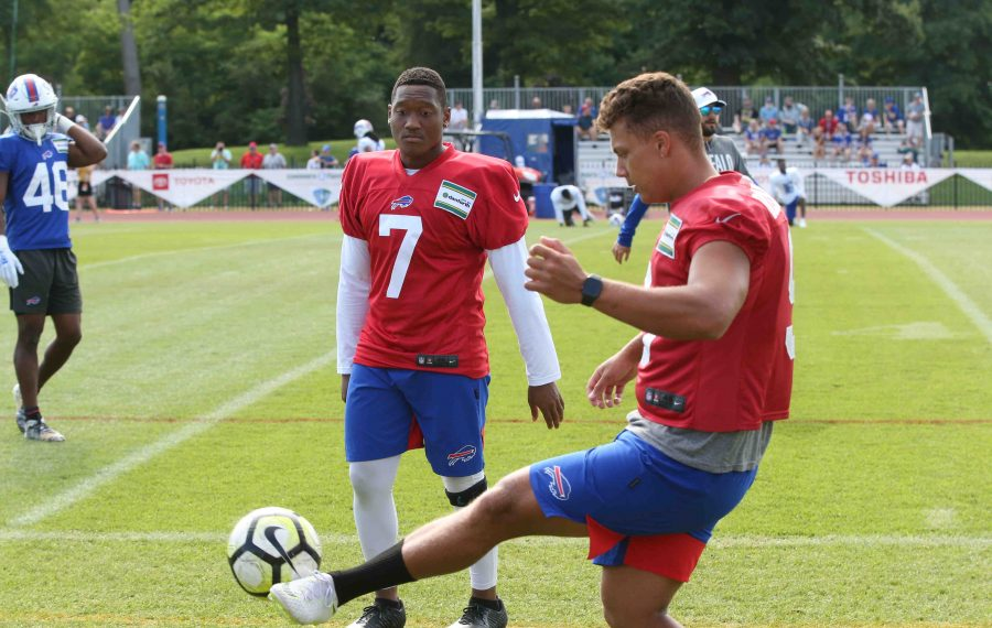 Corey Bojorquez warms up with a soccer ball with Cory Carter (7) before a training camp practice this summer. (James P. McCoy/Buffalo News)