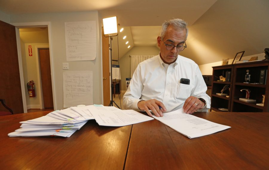 Attorney Steve Boyd signs hard copies of survivor's summons and complaint documents prior to transmitting them as the one-year lookback window on the Child Victims Act opened. (Robert Kirkham/Buffalo News)