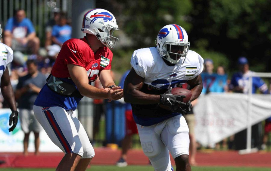 Bills quarterback Josh Allen hands off the ball to LeSean McCoy in a drill during training camp (James P. McCoy/Buffalo News)
