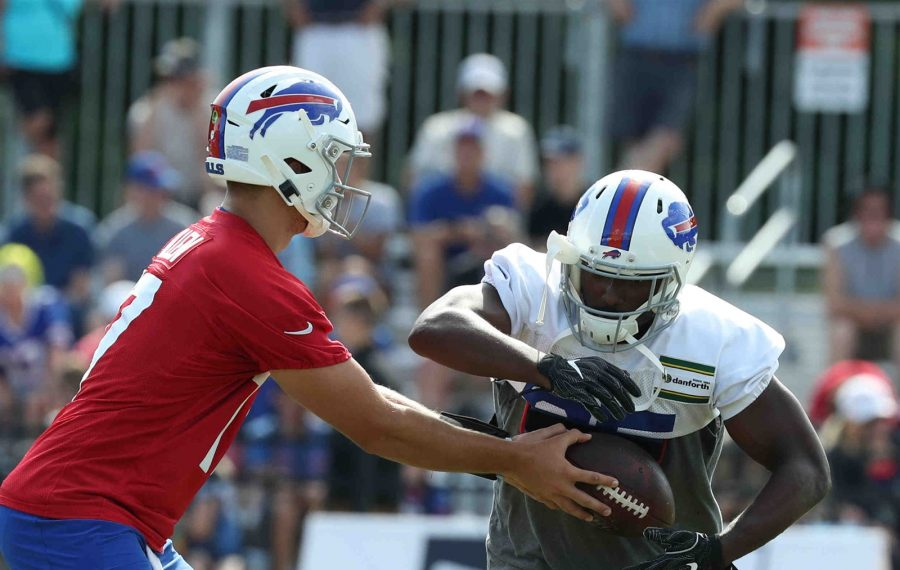 Buffalo Bills running back LeSean McCoy missed practice for personal reasons, but was back at training camp on Thursday. Here, he takes a handoff from Buffalo Bills quarterback Josh Allen (James P. McCoy/Buffalo News)