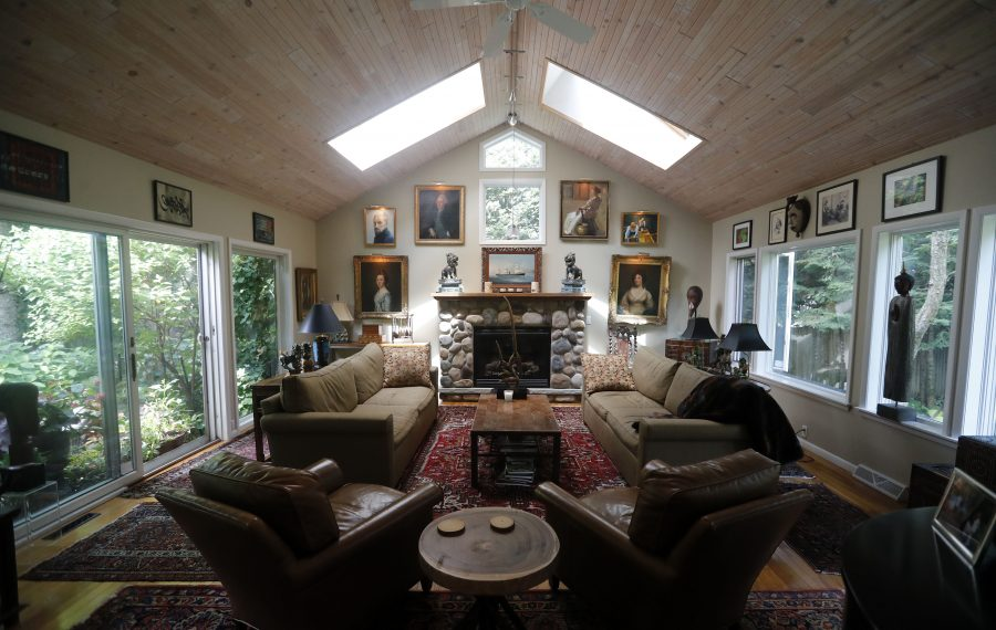 The living room in the home of Peter J. Heffley in Amherst features a cathedral ceiling, skylights, large windows and lots of artwork.         (Mark Mulville/Buffalo News)