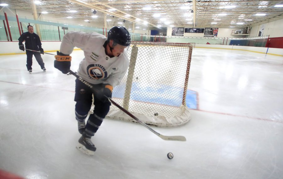 Jeff Skinner works with  Bill Bowler during a workout at the Paramount Ice Complex on Saturday, Aug. 3, 2019. (Harry Scull Jr./Buffalo News)