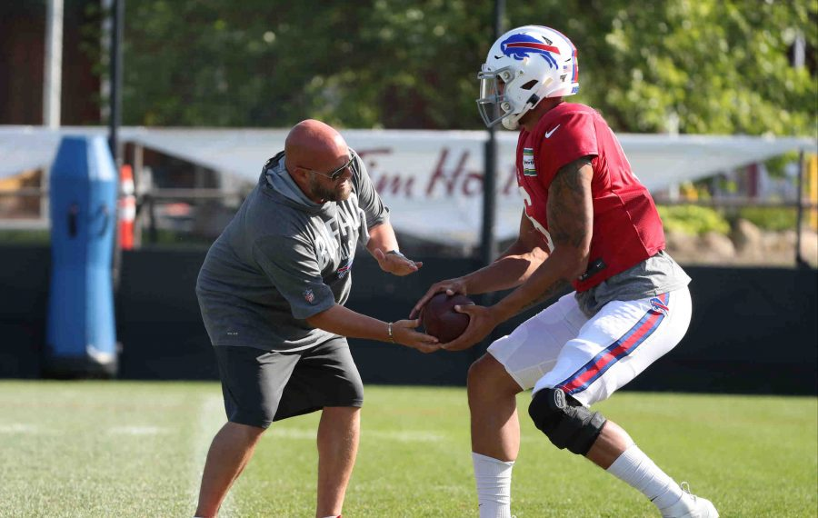 Bills quarterback Tyree Jackson got some one-on-one instruction from offensive coordinator Brian Daboll during a recent practice at training camp. (James P. McCoy/Buffalo News)