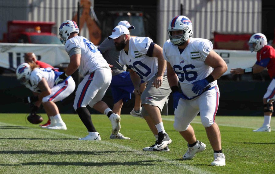 Bills center Mitch Morse lined up with center Russell Bodine in a drill on Monday, Aug. 5, 2019, during Day 10 of training camp at St. John Fisher College. (James P. McCoy/Buffalo News)